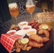 Non-Veg Platter - Crispy chicken wings in barbecue sauce, batter fried jumbo prawns, prawn popcorns and bacon wrapped sausages with 3 types of sauce @ Biere Street, Bangalore