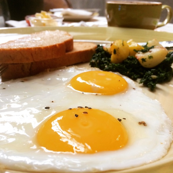 Sunny Side up with spinach and roasted potatoes at Pali Village Cafe, Bandra
